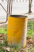yellow trashcan of recycle old fuel tank - stock photo