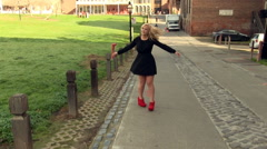 Blond Woman In Black Dress Walking Twirling And Moving - stock footage
