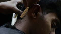 Indian man from side getting haircut Stock Footage