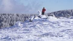 Mountaineer on snowy mountain peak Stock Footage