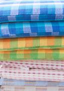 heap of cloth fabric in retail shop - stock photo