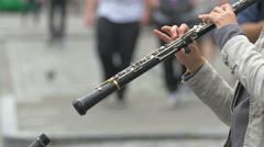 Close up view of a woman playing an oboe in Brussels Stock Footage