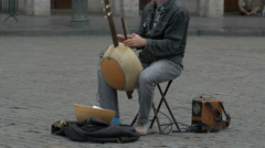 Man playing a kora instrument on the street in Brussels Stock Footage