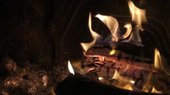 Potatoes wrapped in foil baked in the embers in the fireplace. Stock Footage