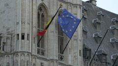 Two flags waving on the City Hall in Brussels Stock Footage