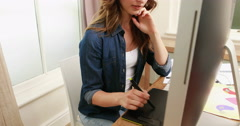 Smiling brunette using digital board Stock Footage