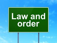 Law concept: Law And Order on road sign background - stock illustration