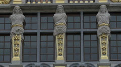 Statues with golden decorations on a building in Grand Place, Brussels Stock Footage