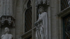 Two statues on the City Hall of Brussels in Brussels Stock Footage