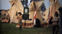 1945: Boy Scouts exploring Indian teepee village exhibit display. - stock footage