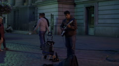 Man playing a guitar in the evening in Brussels Stock Footage