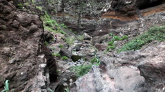 Giant beautiful cliff overhanging the trail in Masca canyon. Tenerife, Canary Stock Footage