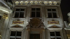 Night tilt up view of a guild hall with golden decorations in Brussels Stock Footage
