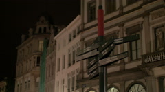 Night view of a post with street indicators in Brussels Stock Footage