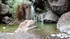 Small creek with waterfalls flowing along hiking route in Masca, Tenerife, Spain Stock Footage