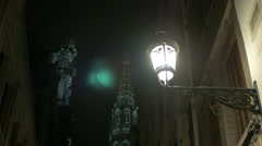 Night view of the City Hall of Brussels tower and a street lamp in Brussels Stock Footage