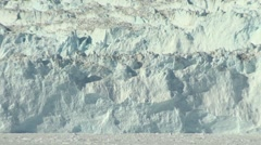 Zoom out from glacier wall to cafe and guests enjoying spectacular glacier view Stock Footage