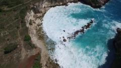 4K HIGH ANGLE FLY BY OF MASSIVE WAVES HITTING ROCK CLIFFS AND BEACH Stock Footage