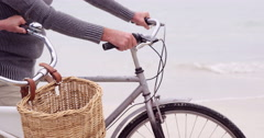 Mid section of mature couple on bikes Stock Footage