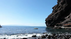 Giant cliffs of Teno massif. Stony beach with pier on the Masca Gorge. Tenerife Stock Footage