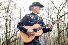 Country musician strumming his guitar Kuvituskuvat