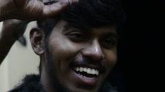 Indian boy laughing hard while getting haircut Stock Footage