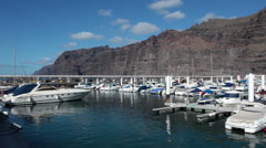 Review of marina of the Los Gigantes Port with pier and moorings, Tenerife - stock footage