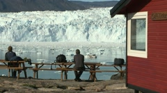 Pan along cafe guests enjoying spectacular glacier view Stock Footage