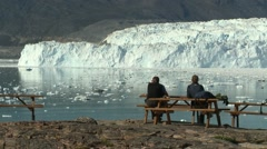 Still of cafe guests enjoying spectacular glacier view Stock Footage