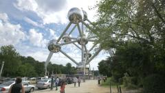 Little girl and other tourists walking close to the Atomium in Brussels Stock Footage