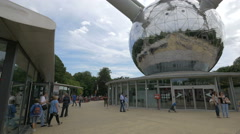 Tourists walking and relaxing near the Atomium museum in Brussels Stock Footage