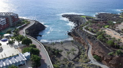 Time lapse of the Playa Paraiso village seascape. Black sand beach, Tenerife Stock Footage