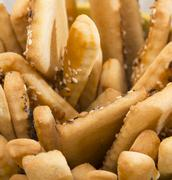 Bread sticks with sesame seeds. Selective focus Stock Photos