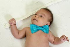 new born baby wearing a blue bowtie - stock photo