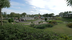 Group of tourists admiring scale models displayed at the Mini-Europe, Brussels Stock Footage