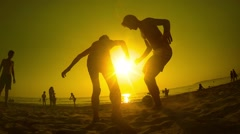 Football silhouette friends play soccer on the beach sunset, SLOW MOTION Stock Footage