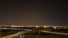 Time lapse with car trails, city skyline and stars Stock Footage