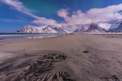Aurora over Skagsanden beach natural patterns Lofoten Norway Europe - stock photo
