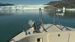 Tip of boat moving towards glacier front in Arctic Stock Footage