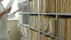 Doctor Nurse medical records at the clinic  Stock Footage