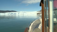 Pan out from boat moving towards glacier front Stock Footage
