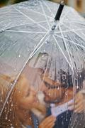Raindrops on umbrella - stock photo