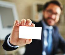 Businessman with visiting card Stock Photos