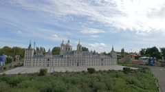 Tourists walking next to the El Escorial at the Mini-Europe, Brussels Stock Footage