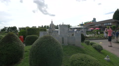 Admiring the Castle of Guimaraes displayed at the Mini-Europe, Brussels Stock Footage