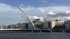Dublin Samuel Beckett Bridge dramatic sky moving clouds Stock Footage