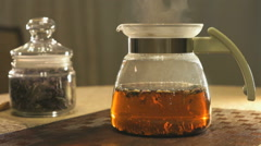 Brewing kipany tea in a glass teapot Stock Footage