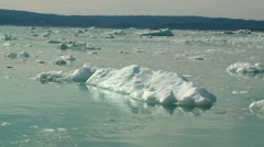 Handheld shot of floating ice in front of calving glacier in Greenland Stock Footage