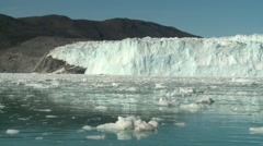 Handheld shot from boat of a glacier front and ice debris floating - stock footage