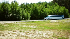 Limousine near trees Stock Footage